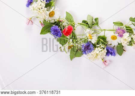 Wreath Of Wildflowers Isolated On A White Background.