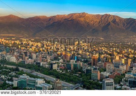 Panoramic View Of Providencia District With Los Andes Mountain Range In Santiago De Chile, South Ame