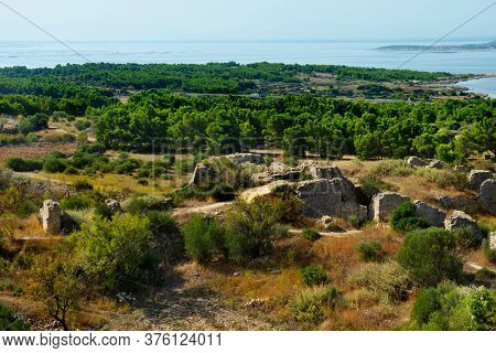 a view of the remains of the Chateau de Leucate castle, in Leucate, France, and the Etang de Leucate lagoon in the background