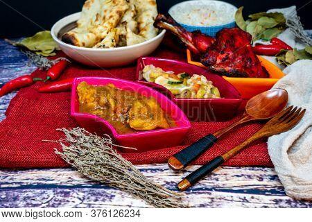Traditional Indian food chicken tandoori and Tikka with garlic naan