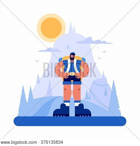 Confident Male Hiker Standing In Mountainous Terrain
