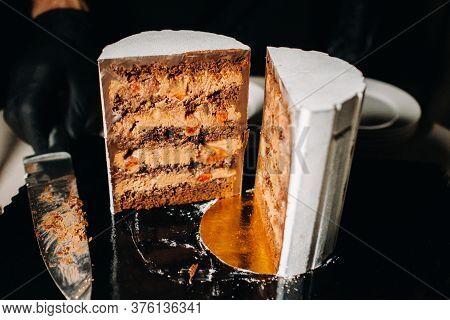Amazing Cakes. Sliced Chocolate Wedding Cake Cake With Amazing Filling On A Black Background.large C