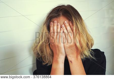 Sad Woman Covers Her Head With Hands. Portrait Of A Weeping Woman. Concept Of Sexual Harassment Agai