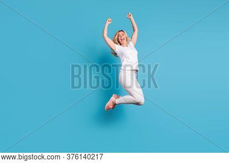 Full Size Photo Of Beautiful Funny Crazy Lady Jumping High Up Celebrating Holiday Raise Fists Astoni
