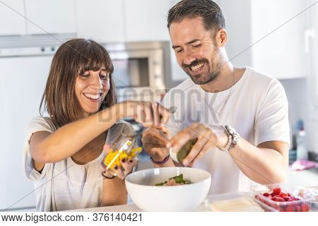 A Caucasian Couple Cooking Together At Home, Cooking In Confinement, Cooking With The Family. Corona