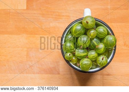 Fresh Organic Gooseberries In A Metal Cup. Fruit Background, Copy Space. Summer Berries Harvest Conc