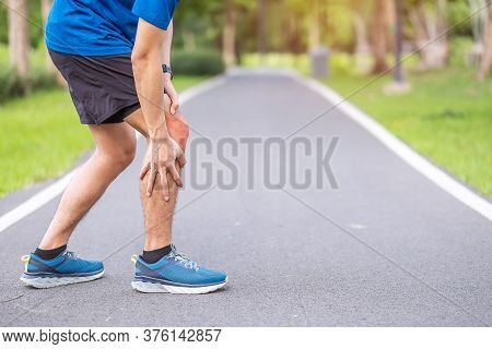 Young Adult Male With Muscle Pain During Running. Runner Have Knee Ache Due To Runners Knee Or Patel