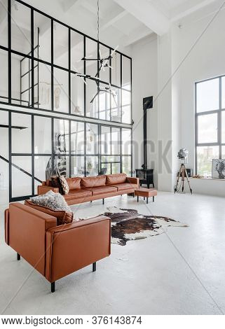 Vertical Photo Of Living Room At Home With Modern Interior, Fireplace Near Leather Comfortable Sofa,