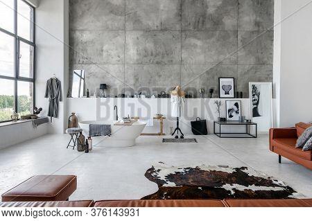 Modern Interior House With Comfortable Bathroom, Bathrobe Near Bath Against Copy Space Wall On Backg