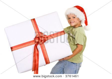 Boy With Santa Hat And Big Present