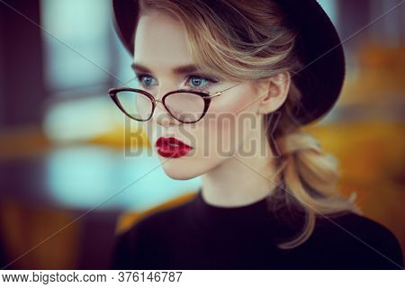 Beautiful girl with elegant romantic appearance in natural light in interior. Beauty, fashion. Optics and eyewear.