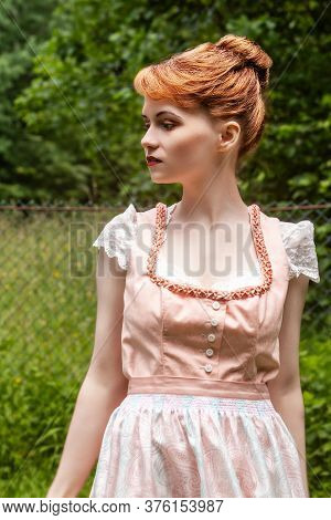 Traditional Costume Worn By A Young Model With Reddish Plug-in Hairstyle