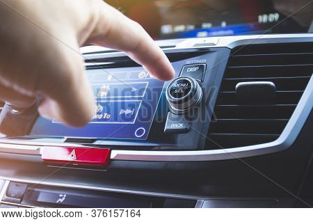 Driver Pressing Menu/select Button Of Car Radio