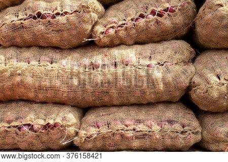 Onion Sacks In An Indian Vegetable Market For Selling And Exporting