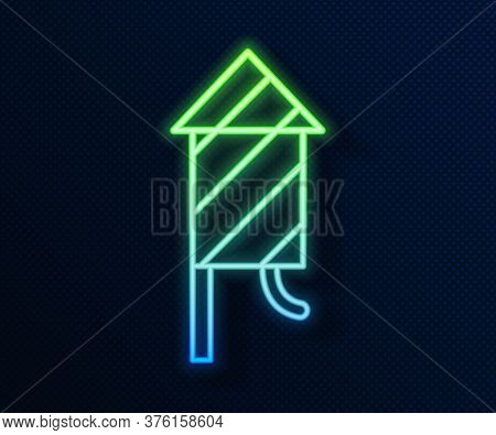 Glowing Neon Line Firework Rocket Icon Isolated On Blue Background. Concept Of Fun Party. Explosive