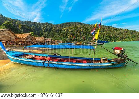 Surin Islands, Phang-nga, Thailand - January 3, 2016: Diesel Traditional Thai Long-tail Boat In Moke