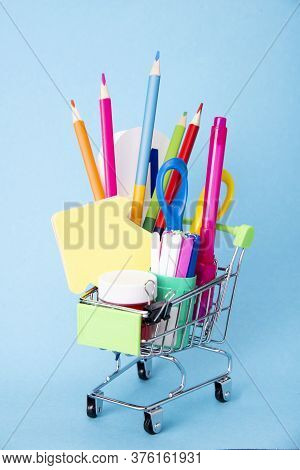 Concept Of Back To School. Shopping Cart With School Supplies