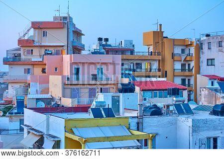 Dwelling houses in Heraklion at twilight, Crete, Greece