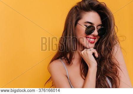 Close-up Portrait Of Joyful Brunette Woman With Red Lips. Photo Of Lovable Dark-haired Girl In Sungl