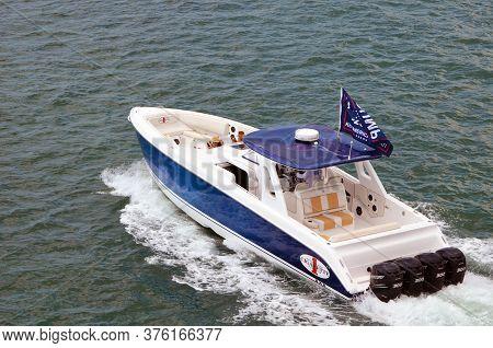 Miami Beach,florida,u.s.a. 11 July 2020.  A High-end Motorboat Flying A Trump