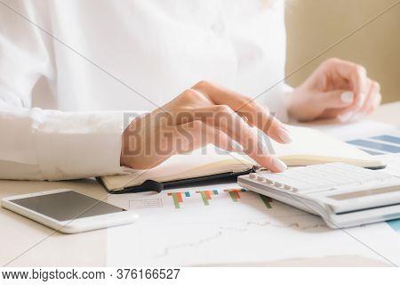 Close Up Businesswoman Hand Using Calculator About Finance Accounting.finance Accounting Concept