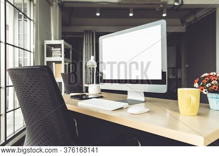Empty Computer Monitor Screen For Design Mock Up Template In Modern Small Office Interior Or Home Of