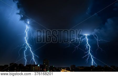 Bright Double Flash Of Powerful Lightning In The City At Nighttime.