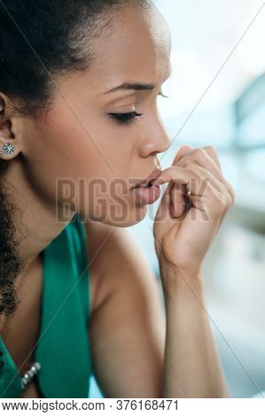 Young Black Woman Feeling Anxious And Biting Nails