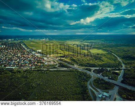 Aerial High Drone Flight Over Evening Road Traffic. Highway And Overpass With Cars And Trucks, Inter