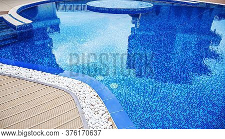 Elements Of A Swimming Pool. Beautiful Swimming Pool With Blue Tiles Closeup.
