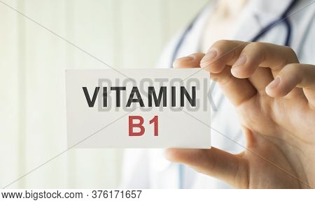 Female Doctor Holding A Tablet With The Text Vitamin B1. Medical Concept.