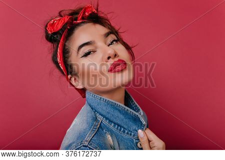 Close-up Portrait Of Fascinating Black-haired Girl With Red Lips. Lovable Female Model With Trendy V