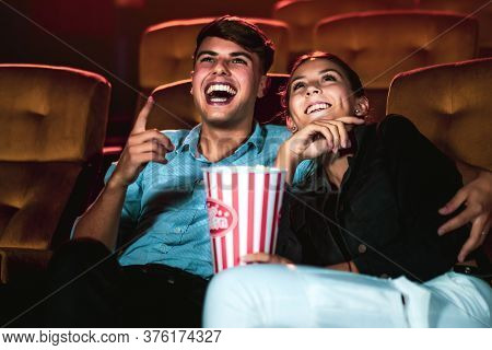 Man And Woman Watching Movie In The Movie Theater Cinema. Group Recreation Activity And Entertainmen