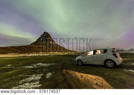 Northern Light Aurora borealis at Kirkjufell Iceland with white car