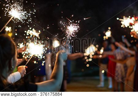 Party Sparklers In The Hands Of Guests At A Party