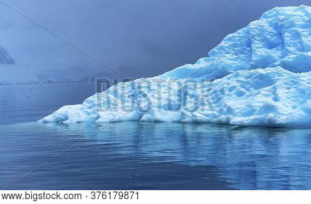 Snowing Floating Blue Iceberg Reflection Paradise Bay Skintorp Cove Antarctica