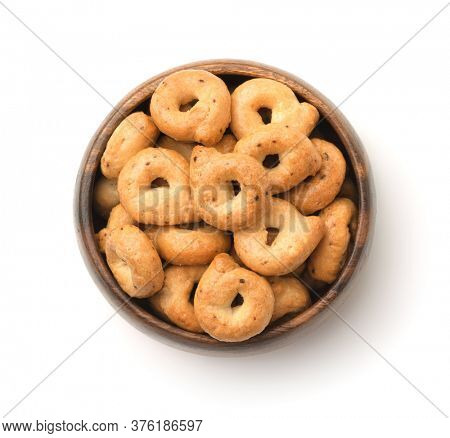 Top view of traditional italian taralli in wooden bowl isolated on white