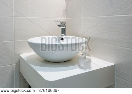 White Washbasin In The Bathroom, In The House, Hotel. Conceptual Photo.