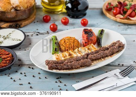 Shish Meatball Kebab From Turkish Cuisine. Served With White Plate On Wooden Table.