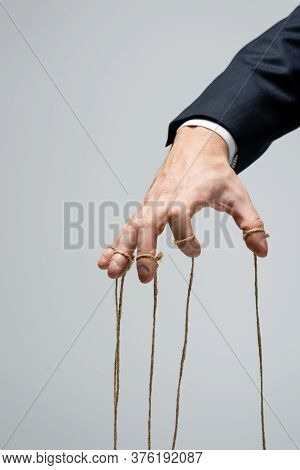 Cropped View Of Puppeteer With Strings On Fingers Isolated On Grey