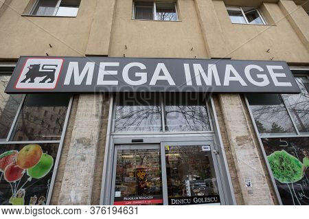 Bucharest, Romania - February 15, 2020: Mega Image Logo In Front Of Their Local Supermarket In Bucha