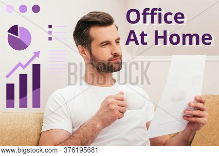 Handsome Teleworker Holding Document And Drinking Coffee On Couch, Office At Home Illustration