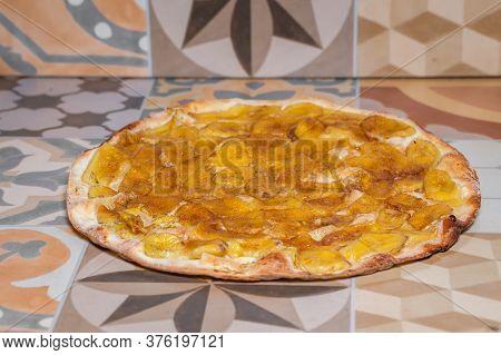 Sweet Pizza With Banana And Cinnamon. Traditional Brazilian Sweet Pizza With Banana