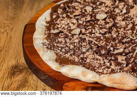 Sweet Pizza, Chocolate Pizza Covered With Chopped Chocolate Candy.