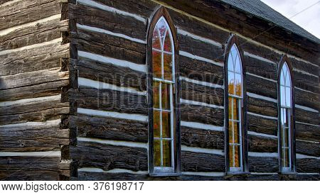 Building Exterior Of The Weathered Wooden Log Cabin Church.