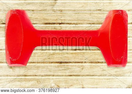 Red Dumbbell For Dog Training On Wood Background. Used For Dog Sport Obedience.