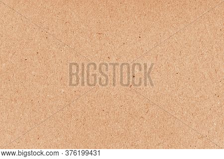 Brown Grainy Corrugated Cardboard Surface. Beige Carton Plain Surface. Grain Paper Texture. Paper Bo