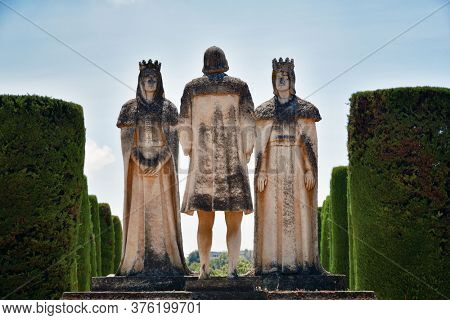 Statue of Christian kings Ferdinand and Isabella and Christopher Columbus in garden of Alcazar of the Christian Monarchs in Cordoba, Spain.