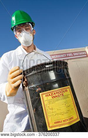 Safety inspector holding hazardous waste