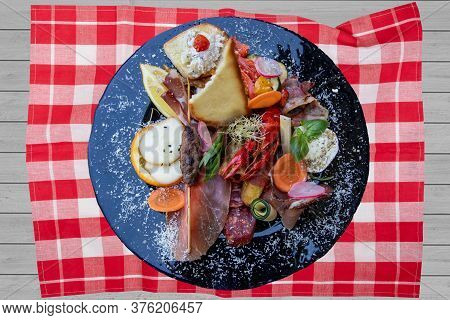 Traditional Italien Food. Closeup Of Mixed Mediterranean Appetizers Or Antipasto And Tapas With Ham